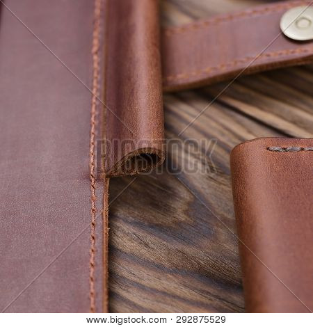 Part Og Red Color Handmade Leather Notebook Cover On Wooden Background. Stock Photo Of Luxury Busine