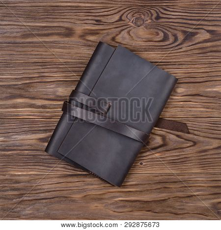 Brown Handmade Leather Notebook Cover On Wooden Background. Stock Photo Of Luxury Business Accessori