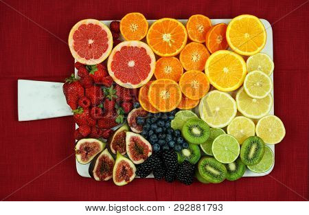 Colorful Fruit Platter Assembly With Rainbow Color Fruit Pieces Including Citrus, Berries, Figs, And
