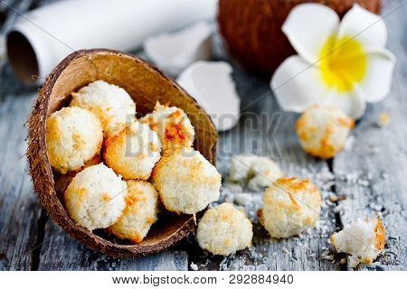 Homemade Coconut Candies From Coconut Chips, Round Crumbly Coconut Cookies In Half Coconut Shell On