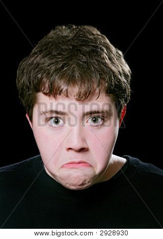 Angry Teen Face Over Black