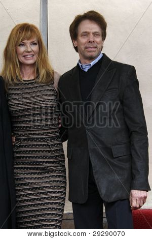 LOS ANGELES - JAN 23: Jerry Bruckheimer; Marg Helgenberger at a ceremony where Marg Helgenberger is honored with a star on the Hollywood Walk of Fame on January 23, 2012 in Los Angeles, California