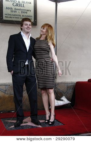 LOS ANGELES - JAN 23: Hugh Rosenberg (son); Marg Helgenberger at a ceremony where Marg Helgenberger is honored with a star on the Hollywood Walk of Fame on January 23, 2012 in Los Angeles, California