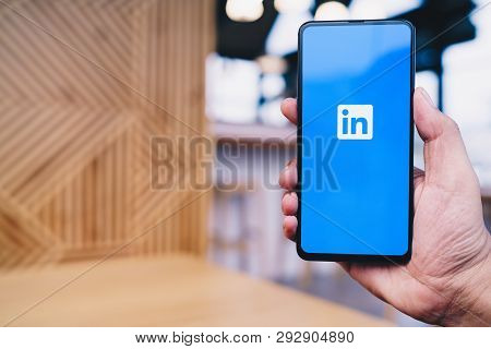 Chiang Mai, Thailand - Mar. 23,2019: Man Holding Xiaomi Mi Mix 3 Mobile Phone With Linkedin Applicat