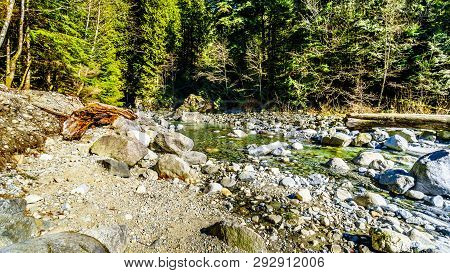 Boulders In The Crystal Clear Water Of Cascade Creek Right After The Falls In Cascade Falls Regional