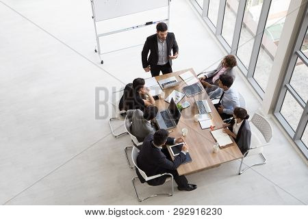 Top View Of Group Of Multiethnic Busy People Working In An Office, Aerial View With Businessman And
