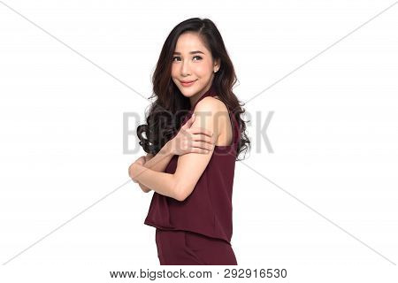 Happy young casual asian woman hugging herself isolated on white background. Love yourself concept poster