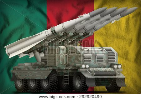 Tactical Short Range Ballistic Missile With Arctic Camouflage On The Cameroon Flag Background. 3d Il