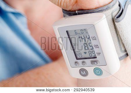 Health Problem, High Blood Pressure. Man Measuring His Blood Pressure