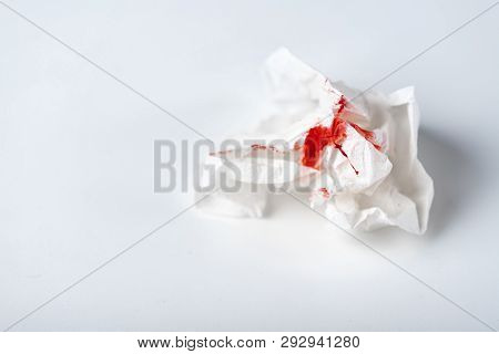 A Photo Of Used Bloody Toilet Paper On The Light Blue Background