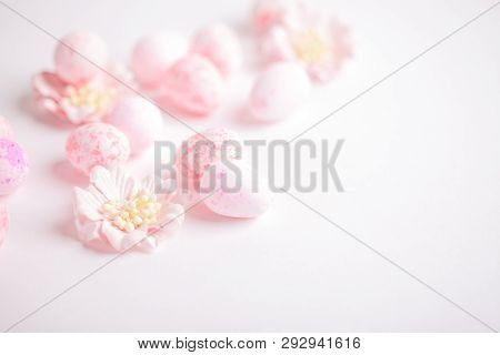 Pink Easter Eggs And Flowers On White Background