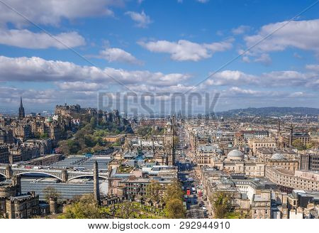 Panorama Of Old Town Edinburgh With Princess Street Against Castle In Scotland