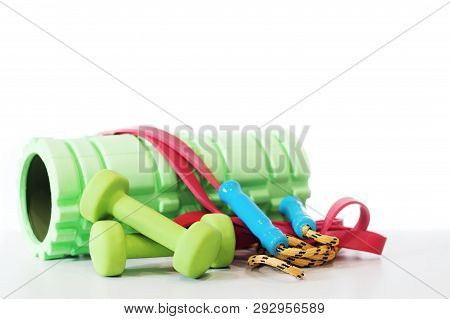 Woman Fitness Equipment Isolated On White Background. Foam Roller, Elastic Band,jump Rope, Dumbbell