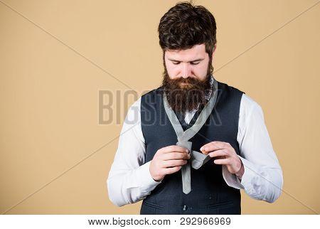 Looking Classy. Elegant Man. Bearded Man Tying A Tie. Brutal Caucasian Man Adjusting Fashion Accesso