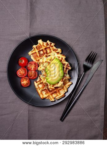 Healthy Breakfast. Savory  Waffles With Avocado And Tomatoes On A Black Plate
