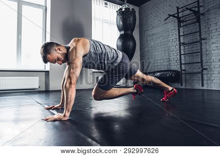 Run As You Breath. The Athlete Trains Hard His Lower And Upper Body In The Gym, Doing Exercises For