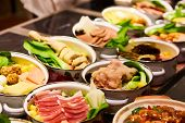 Assorted Chinese food set. Chinese noodles, fried rice, dumplings, peking duck, dim sum, spring rolls. Famous Chinese cuisine dishes on table. Top view. Chinese restaurant concept. Asian style banquet poster