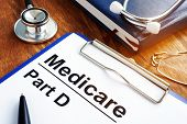Medicare Part D documents with clipboard on a desk. poster