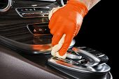 A man cleaning car with microfiber cloth. Car detailing or valeting concept. Selective focus. Car detailing. Cleaning with sponge. Worker cleaning. Car wash concept solution to clean poster