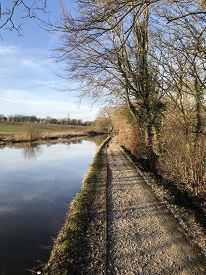 The Shropshire Union Canal Towpath (upton-by-chester, England, Uk) Recedes Into The Distance In Brig