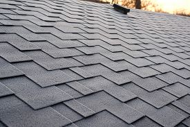 Close Up View On Asphalt Roofing Shingles Background. Roof Shingles - Roofing. Roof Shingles Covered
