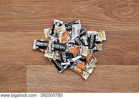 Many Nescafe Caramel Cream Coffee Sticks On Wooden Background. Nescafe Is A Brand Of Coffee Made By