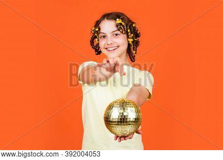 Fancy Teen. Cheerful Girl With Disco Ball. Fashion Kid Posing With Curlers In Hair. Night Club. Hair