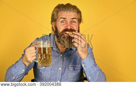 Consume Alcohol. Enjoy Your Meal. Beer And Food. Dinner At Pub. Hungry Man Drink Beer And Eat Snacks