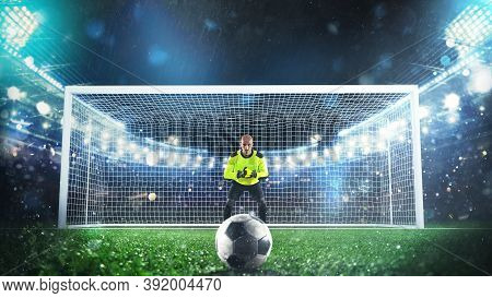 Soccer Goalie Ready To Save A Penalty Kick At The Stadium