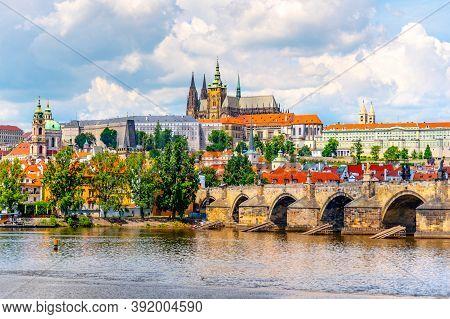 Prague Panorama With Prague Castle And Charles Bridge Above Vltava River, Prague, Czech Republic.