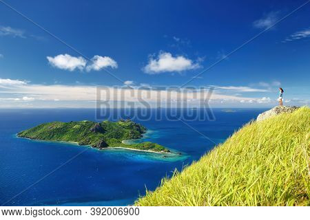 View Of Kuata Island From Wayaseva Island With A Hiker Standing On A Rock, Yasawa Islands, Fiji