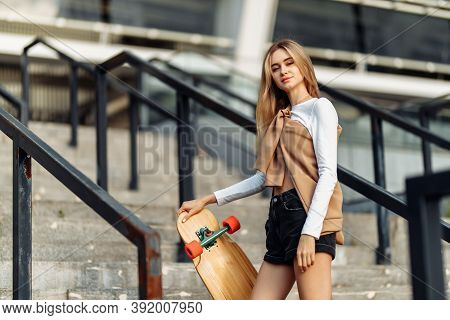 Beautiful Blonde With A Skate In Her Hands.