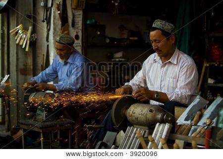 Uyghur Craftsmen Sharpening Knives