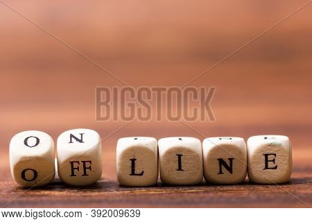 Online And Offline Printed On Wooden Cubes