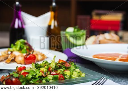 Top View Of A Restaurant Table Served With A Multi-course Set Lunch And Drink. Complex Lunch. Comple