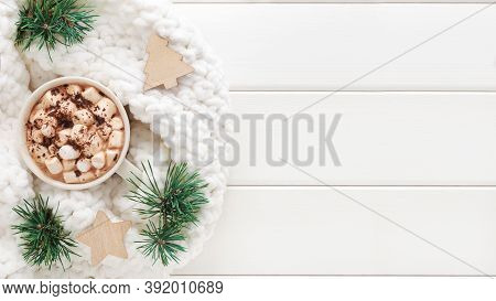 Hot Cocoa With Marshmallows Surrounded By Winter Decorations On White Wooden Background. Flat Lay, T