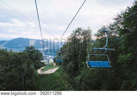 Bukovel, Ukraine - July 2020: Ski Lift Working In The Carpathian Mountains During Summertime. Summer