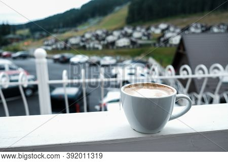 White Cappuccino Mug On A Balcony. Beautiful Quiet Morning In The Mountains. Fresh Cup Of Coffee Wit