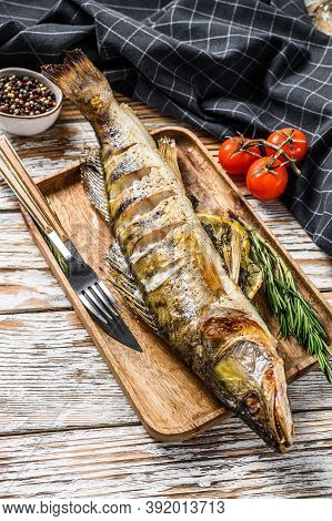 Baked Zander, Walleye Fish With Herbs And Lemon. White Wooden Background. Top View