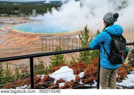 Tourist Enjoying The View Of Grand Prismatic Spring In Midway Geyser Basin, Yellowstone National Par