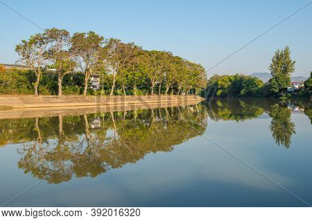 Beautiful Reflection And Tranquility Of Wang River, The River Flowing Pass The Centre Of Lampang Dow