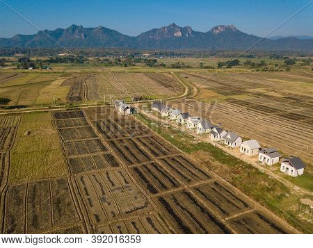 Aerial View Of The Landscape In The Countryside Of Lampang Province Of Thailand. The Mountains In Th