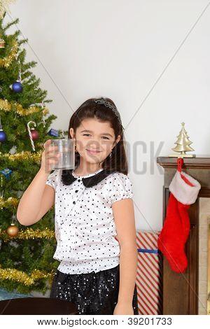 Little girl drank santa milk