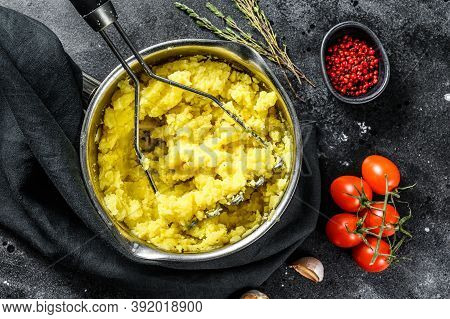 Mashed Potatoes With Milk And Eggs In A Pot. Black Background. Top View