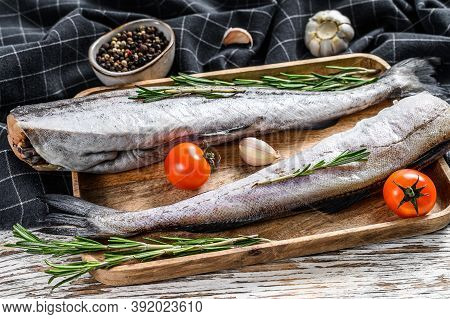 Whole Fish Pollock. Raw Seafood. White Background. Top View