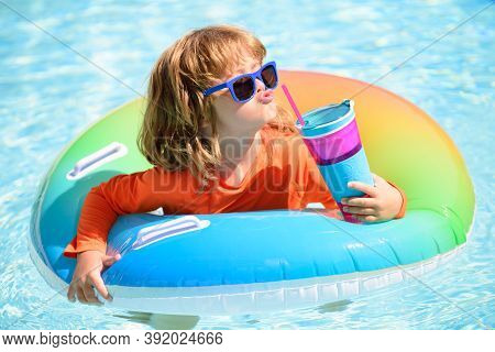 Summer Child Cocktail Party In Watter Pool In The Summer. Little Boy Relax And Swimming In Swimming