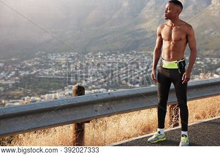 Full Length Male Runner With Muscular Body, Has Marathone Training, Thoughtful Expression, Admires B