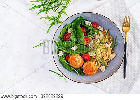 Italian Pasta. Pasta  With Meatballs,  Cheese And Fresh Salad On Light Background. Dinner. Top View,