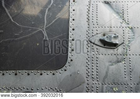 The Wreckage Of The Plane, Part Of The Fuselage And Window Of The Broken Plane At The Dump Of Non-fe