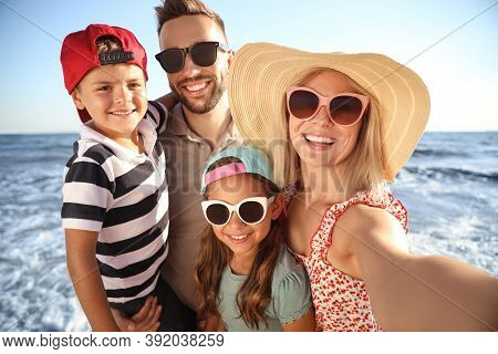 Happy Family Taking Selfie On Beach Near Sea. Summer Vacation